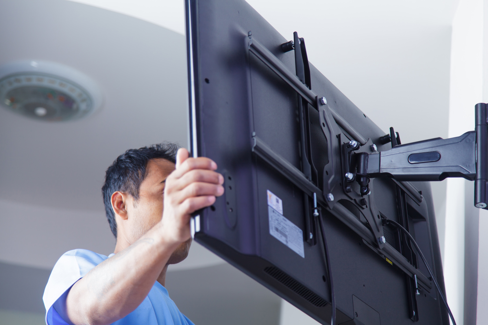 Installing mount TV on the wall at home or office